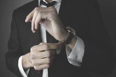 Bedrijfsmens en horloge Stock Afbeeldingen
