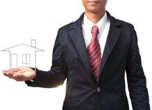 Bedrijfsmens en huis op hand voor multifunctioneel Royalty-vrije Stock Foto
