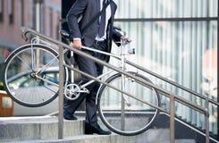 Bedrijfsmens en zijn fiets stock foto's