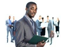 Bedrijfsmens en zijn team over een witte achtergrond Royalty-vrije Stock Afbeeldingen