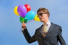 Bedrijfsmens met ballons Stock Fotografie