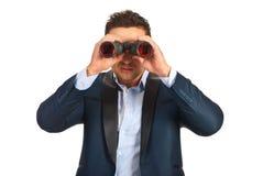 Bedrijfsmens met binoculair Stock Afbeeldingen