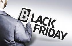 Bedrijfsmens met de tekst Black Friday in een conceptenbeeld Royalty-vrije Stock Foto's