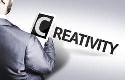 Bedrijfsmens met de tekstcreativiteit in een conceptenbeeld Royalty-vrije Stock Afbeelding