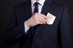 Bedrijfsmens met euro bankbiljetten in de zak Royalty-vrije Stock Foto's