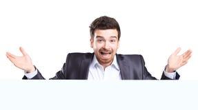 Bedrijfsmens met het geschokte uitdrukking voorstellen Stock Fotografie