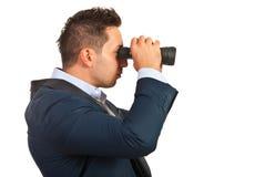 Bedrijfsmens met kijker Stock Foto's