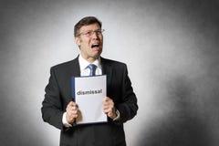 Bedrijfsmens met ontslag royalty-vrije stock afbeeldingen