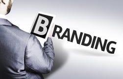 Bedrijfsmens met tekst het Brandmerken in een conceptenbeeld Royalty-vrije Stock Afbeelding