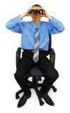 Bedrijfsmens met verrekijkers op bureaustoel Royalty-vrije Stock Afbeelding
