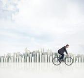 Bedrijfsmens op een fiets Stock Afbeelding