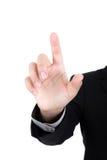 Bedrijfsmens wat betreft het denkbeeldig scherm tegen royalty-vrije stock afbeelding