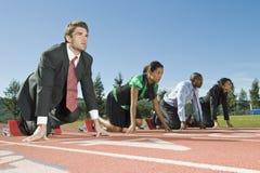 Bedrijfsmensen bij Startblokken Stock Afbeelding