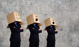 Bedrijfsmensen die dozen dragen Royalty-vrije Stock Fotografie