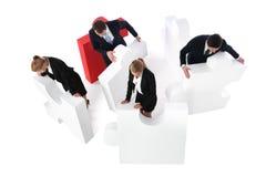 Bedrijfsmensen die raadsel assembleren Royalty-vrije Stock Afbeelding