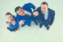 Bedrijfsmensen die zich - u richten verenigen die Stock Foto