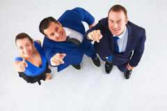 Bedrijfsmensen die zich - u richten verenigen die Stock Foto's