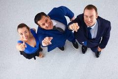 Bedrijfsmensen die zich - u richten verenigen die Royalty-vrije Stock Afbeelding