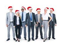 Bedrijfsmensen in Kerstmishoeden royalty-vrije stock foto's