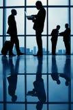Bedrijfsmensen in luchthaven Stock Afbeeldingen