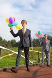 Bedrijfsmensen met ballons Stock Foto