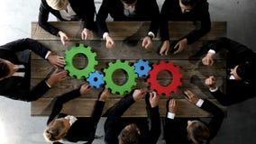 Bedrijfsmensen met radertjes van zaken stock videobeelden
