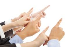 Bedrijfsmensenhanden die dezelfde richting tonen Stock Foto's