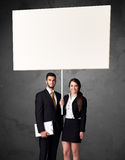 Bedrijfspaar met spatie whiteboard Royalty-vrije Stock Foto