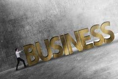 Bedrijfspersoon die 3D bedrijfswoordhelling duwen Royalty-vrije Stock Afbeelding