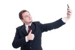 Bedrijfspersoon die een selfie nemen en tonen als stock fotografie