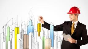 Bedrijfspersoon die een stadsgezicht schetsen Royalty-vrije Stock Afbeelding