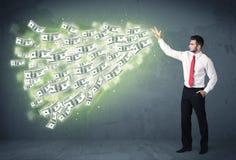 Bedrijfspersoon die heel wat concept van dollarrekeningen werpen Royalty-vrije Stock Foto