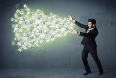 Bedrijfspersoon die heel wat concept van dollarrekeningen werpen Royalty-vrije Stock Foto's