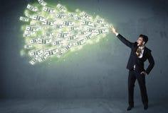 Bedrijfspersoon die heel wat concept van dollarrekeningen werpen Royalty-vrije Stock Afbeelding