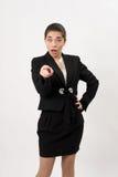 Bedrijfsvrouw die een vinger tonen bij de camera stock foto