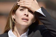 Bedrijfsvrouw die met Hoofdpijn Kostuum dragen Royalty-vrije Stock Afbeelding