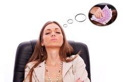 Bedrijfsvrouw die over geld dromen Stock Fotografie