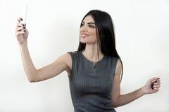 Bedrijfsvrouw die selfie nemen stock afbeelding