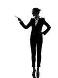 Bedrijfsvrouw die tonend silhouet richten stock foto