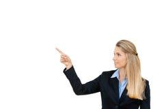 Bedrijfsvrouw die witte exemplaarruimte richt Stock Foto's