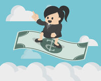 Bedrijfsvrouw die zich op de vliegende magische dollar bevinden royalty-vrije illustratie