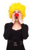 Bedrijfsvrouw met clownpruik en neus Stock Afbeeldingen