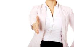 Bedrijfsvrouw met een open hand klaar voor handdruk royalty-vrije stock afbeeldingen