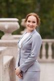 Bedrijfsvrouwen in grijs kostuum Stock Fotografie