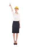 Bedrijfsvrouwenarchitect die in gele bouwershelm zo richten bij Stock Afbeeldingen