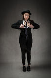 Bedrijfsvrouwenstrook met Engelse kleding stock afbeeldingen