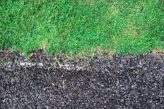 Bedrock and Green grass. Texture background Stock Photos