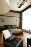 Bedroom. Interior of a bedroom with wide window Royalty Free Stock Photography