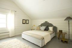 Bedroom. Wide bedroom in the attic Stock Images