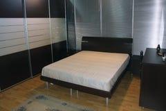 Bedroom. Photo of functional modern minimalistic bedroom Stock Images